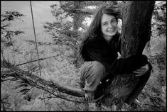 """Magnum Photos Stuart Franklin View profile USA. California. Julia """"BUTTERFLY"""" Hill in a 200 foot ancient redwood tree named """"Luna"""". She has lived in the sequoia """"Luna"""" for the past year to protect it from deforestation. 1998.-"""