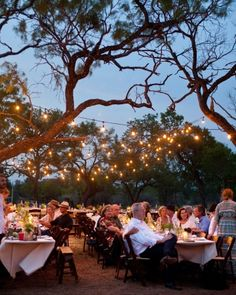 bistro lights  Casual Canopy    At a laid-back Texas wedding full of rustic details, basic bistro lights were strung to create a canopy effect over dinner tables.  See More of this Real Wedding