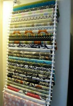 dowels and ribbon, easy fabric storage that can be hidden by hanging inside a closet