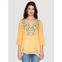 Tropic Blouse Embrace bohemian style in the Johnny Was TROPIC BLOUSE, which features a stunning embroidery design that combines playful floral and geometric elements. With a figure-flattering cut in flowy rayon georgette, this embroidered top is sure to become one of your favorites!  - Rayon Georgette - V-Neckline, ¾ Length Sleeves - Signature Embroidery - Care Instructions: Machine Wash Cold, Tumble Dry Low