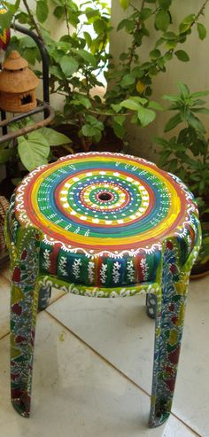 old plastic stool got a new makeover.  painted in acrylic on plastic polymer surface...