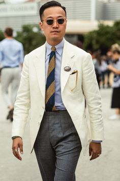 Kenji Cheung of Bryceland's & Co balances his cream single-breasted jacket with a tailored grey wool trouser. Mens Suits Uk, Grey Suit Men, Suit Fashion, Mens Fashion, Preppy Summer Outfits, Designer Suits For Men, Suits For Sale, Grey Trousers, Well Dressed Men