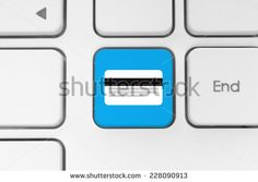 Blue button with credit card on the keyboard close-up