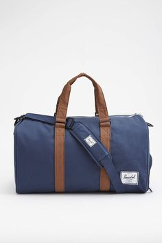 The Herschel Supply Novel Duffle Bag features a removable shoulder strap and Herschel Supply's signature shoe compartment, the Novel duffle is ideal for weekend getaways. Carry On Tote, Jack Threads, Herschel Supply Co, Duffel Bag, Travel Bags, Traveling By Yourself, Gym Bag, Shoulder Strap, Novels