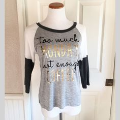 """Amazing Soft Not Enough Coffee Top So soft and amazing! """"Too much Monday not enough Coffee"""" screen print in black and gold.  ⚜www.lovelionessie.com⚜ Please do not buy this listing. Comment below and I'll create a separate listing for you.   100% Rayon  S:3-5, M:7-9, L:11-13  ❌No trades, no PayPal, no holds Instagram: @lovelionessie ⚜www.lovelionessie.com⚜ Tops Tees - Long Sleeve"""