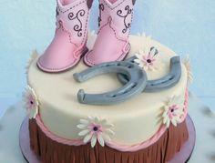 Sweet Baby shower cake with baby cowboy boots, horseshoes and western fringe.