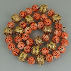 Qing Dynasty Chinese court necklace. Carved dragon beads of natural salmon coral and 18k gold. 19thC. 59cm long.