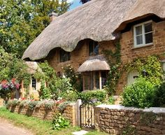 Thatched cottage. I'd like to rent one of these and live in it for a month or two.