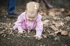 Family portrait session with baby in the leaves at Yorktown Beach, Virginia | www.mariagracephoto.com