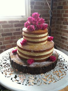 Naked wedding cake (banana cake with cream cheese filling topped with fresh flowers)