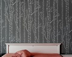 tree stencil for the wall. a fun project and a lot cheaper than amazing wall paper!