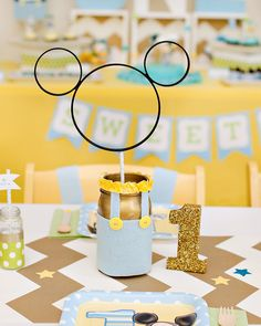 DIY Mickey Mouse Centerpiece Idea made with a painted mason jar and embroidery hoops