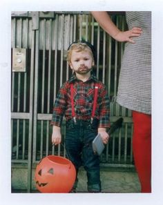 Rugged men love beards, plaid shirts, suspenders, and implements of destruction. You go, little man!