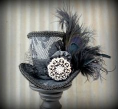 Hey, I found this really awesome Etsy listing at https://www.etsy.com/listing/173532851/black-and-silver-opera-mini-top-hat