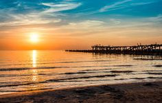 Wooden Pier Or Jetty And A Boat On A Lake Sunset. Versilia Tusca - Download From Over 45 Million High Quality Stock Photos, Images, Vectors. Sign up for FREE today. Image: 44955801