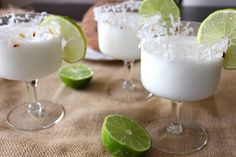 Coconut Margarita  •1 cup sweetened shredded coconut  •½ teaspoon salt  •½ cup freshly squeezed lime juice, plus 2 tablespoons for glasses (about 5 limes)  •¾ cup Coco Lopez or cream of coconut  •½ cup plus 2 tablespoons tequila  •¼ cup Cointreau or other orange liqueur
