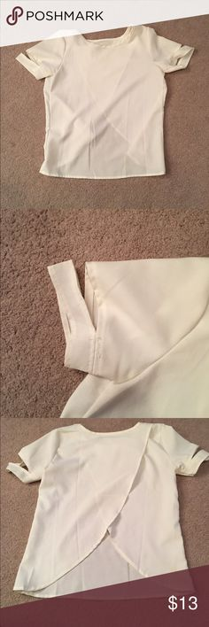 White blouse Beautiful white blouse white slits in the sleeves, and an open back. Size small and in great condition! Tops Blouses