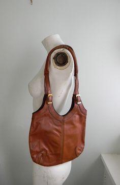 vintage. 70s Classic Hobo Bag // Leather 70s Purse // The Original Hobo. $42.25, via Etsy.