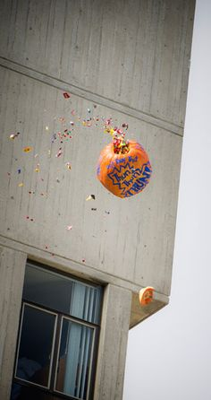 How does UC San Diego celebrate Halloween? We drop a candy-filled pumpkin off of one of the tallest building on campus. Photo by Erik Jepsen/UC San Diego Publications. America's Finest, San Diego, Pumpkin, College, Drop, Candy, Traditional, Lifestyle, Halloween