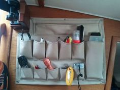 Small Boat Projects - Making Life Aboard Easier: canvas pockets good idea for where we keep the tool box, we can have tools we use most often in here so we dont always have to pull the box out Sailboat Living, Living On A Boat, Boat Building Plans, Boat Plans, Boot Dekor, Boat Organization, Liveaboard Sailboat, Liveaboard Boats, Boat Cleaning
