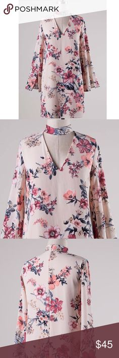 CCO New arrival Long sleeve mock neck floral dress Bell sleeves with slit, mock neck, front cutout, back zipper, floral print, woven dress with lining. 100% polyester. Made in USA. Happy to answer questions! Sizing fits slightly small. Size small=0/2 size medium=4/6 size large=8/10 Dresses Mini