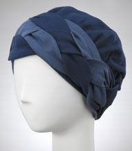 Tucks 'N Darts Reversible Hat with two overlay ties and one overlay braid