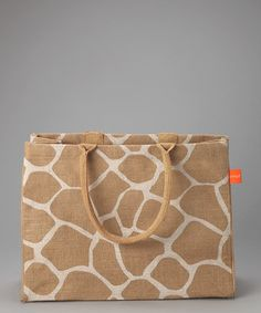 This modern bag is made of environmentally friendly jute, a vegetable fiber that grows in abundance and requires minimal fertilizer. An inside zipper pocket and soft, woven handles complete the go-to carrier.