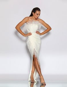 J'adore This dress is sure to make a fashion statement at any event! A strapless satin gown with feather accents across the bust line and the leg slit. Wedding Dress With Feathers, Feather Dress, Bridesmaid Dresses, Prom Dresses, Wedding Dresses, Strapless Gown, Satin Gown, Bustier, Dance Dresses