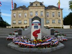 Liberty Road (La voie de la liberté) is marking the victorious route of the Allied forces from D-Day in June 1944. It starts in Sainte-Mère-Église, travels across Northern France to Metz and then northwards to end in Bastogne, on the border of Luxembourg and Belgium. At each of the 1,146 kilometers, there is a stone marker or 'Borne'. The first is this one (0km) outside the town hall in Sainte-Mère-Église. (Normandy, France)