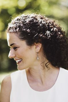 This bride simply added a jewelled hair pin to her tumbling curls.  Photo | Snipped & Ink