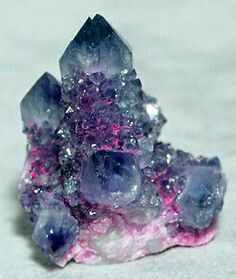 Quartz - purple Likely Amethyst, & Blue probable blue quartz. Pretty but never used as a semiprecious gem, to my  Knowledge.