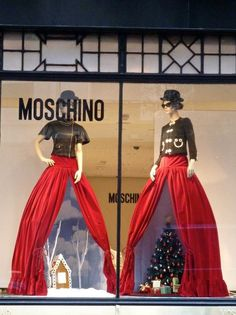 "Christmas display underneath the ""good china"" on the mannequins"