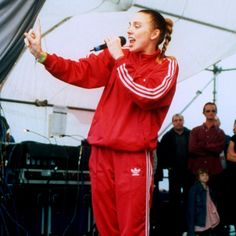 Melanie Chisholm performing in her Adidas tracksuit with the Spice Girls in 1997