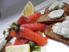 Krostini with smoked salmon and caper (black bread,s moked salmon, lemon juice, olive oil, caper, spice butter)
