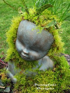 DIY doll head planter created from Barbie doll type styling heads.