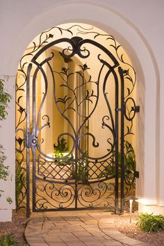 by Grizzly Iron, Inc, Phoenix, AZ, US 85007 ·   Entry Gate http://www.grizzlyiron.com   Entry gate with many forged details, including calla lilies and leaves, scrollwork and basket weave.