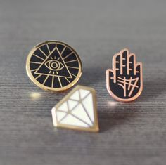 Mysteries of the ancient societies are veiled in the symbology of this enamel pin. The all-seeing eye is enclosed in a pyramid, reminding us all that the Illuminati just might see and know all. Wear i