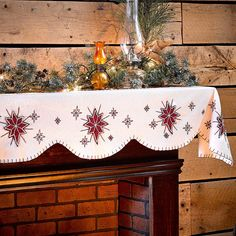 """North Star Mantel Scarf. This creme mantle scarf measures 14"""" x 72"""" and is 100% felt. This mantle scarf is scalloped and features red felt north stars of varying sizes and each is hand embroidered. Edging is whip stitched."""
