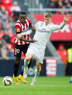 Toni Kroos (R) of Real Madrid CF duels for the ball with Inaki Willams of Athletic Club Bilbao during the La Liga match between Athletic Club Bilbao and Real Madrid CF at San Mames Stadium on March 7, 2015 in Bilbao, Spain.