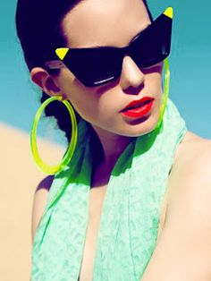 Funky tipped sunglasses and translucent hoops.