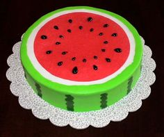 Watermelon cake - A friends son was turning 6 and wanted a cake that looked like watermelon, so this is what I came up with. The cake is iced in buttercream. The red is a circle of wafer paper sprayed red with food color spray. The seeds are black piping gel.