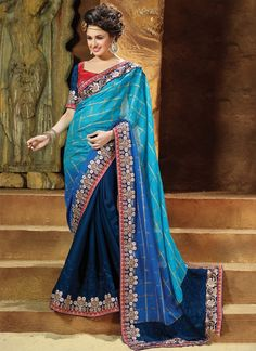 Design and style and trend would be at the peak of your splendor once you attire this blue jacquard and georgette designer saree. You are able to see some fascinating patterns completed with embr...