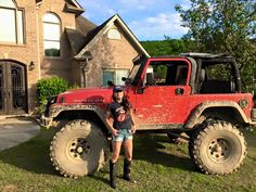 that's a happy Jeep Girl . . .   beside her muddy red lifted big-tire roll-bar dirty topless JEEP rubicon  <3