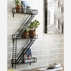 Buy New York Fire Escape Rack in Singapore,Singapore. New York, New York. The humble fire escape is as much an icon of the city as the grand buildings around. Think Holly Golightly singing on the fire escape in Bre Chat to Buy Display Shelves, Wall Shelves, Unique Shelves, Book Shelves, Wall Storage, Unique Bookshelves, Bookshelf Wall, Staircase Bookshelf, Black Staircase