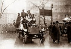 1913, and shows the New York City Fire Department with one of its first motorized firetrucks