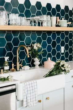 I love the white surfaces and cupboards with the copper taps and knobs. The tiles and black shelve are OBV amazing.
