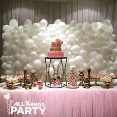 Stunning balloon cloud backdrop for an amazing dessert buffet table for a…