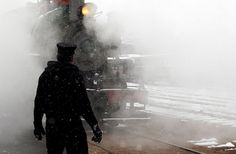 Steam and snow surround Mike Grimm waits for the engine of a vintage 1880 train to back into position in Hill City, South Dakota. Riders on the popular summertime tourist attraction got a very wintertime view as a storm brought as much as 8 inches of snow to parts of the Black Hills. Snowfall in downtown Rapid City marked the earliest such event since 1888; that was before South Dakota was even a state.