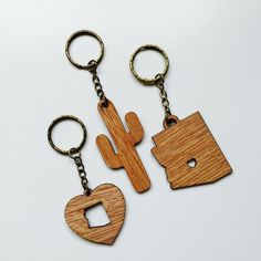 Laser-cut wood keychains with hammered brass keyring.