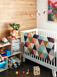 Blanket color scheme would match the existing wall colors well - and gender neutral!